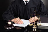 Judge Writing On Paper At Desk — Stock Photo