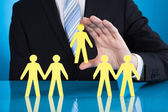 Businessman Holding Paper People Representing Recruitment — Stock Photo