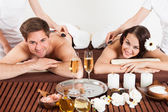Happy Couple Receiving Shoulder Massage At Beauty Spa — Stock Photo