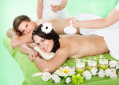 Couple Receiving Massage With Herbal Compress Balls — Stock Photo