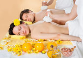 Couple Receiving Massage With Herbal Compress Stamps At Spa — Stock Photo