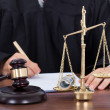 Male Judge Signing Document In Courtroom — Stock Photo #48087891