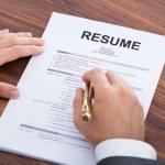 Businessman Analyzing Resume — Stock Photo #48087943