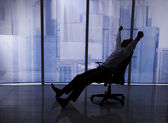 Businessman Stretching On Chair — Stock Photo