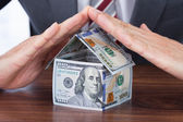 Businessman Sheltering House — Stock Photo