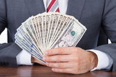 Businessman Holding Fanned Banknotes — Stock Photo