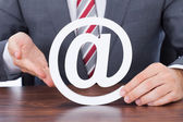 Businessman Shielding Internet Icon — Stock Photo