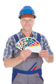 Handyman Showing Color Swatches — Stock Photo