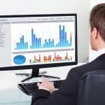 Businessman Analyzing Graphs — Stock Photo #48092075