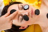 Woman Receiving Hot Stone Therapy — Stock Photo