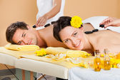 Couple Receiving hot stone Therapy — Stock Photo