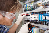 Electrical Engineer Examining Fusebox — Stock Photo