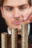 Young Businessman Stacking Coins — Stock Photo
