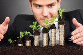 Businessman Protecting Coins — Stockfoto