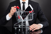 Businessman With Shopping Cart  And Mobile Phone — Stock Photo