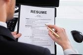 Businessman Analyzing Resume — Stock Photo
