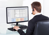 Businessman In Headset Using Computer — Stock Photo