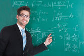 Confident Professor Against Blackboard — Stok fotoğraf