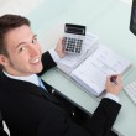 Businessman Calculating Finance — Stock Photo #48489931