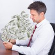 Businessman Looking At Money — Stock Photo #48491913