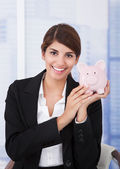 Businesswoman Holding Piggybank — Stock Photo