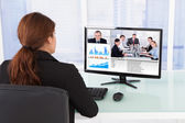 Businesswoman Video Conferencing With Team On Computer — Stock Photo