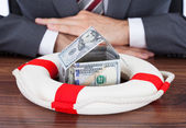 Businessman Protecting Money House — Stock Photo