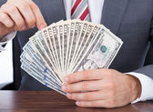 Businessman Holding Banknotes — Stock Photo