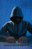 Man In Balaclava Hacking Laptop — Foto Stock