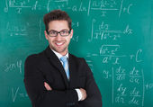 Professor Standing Against Blackboard — Stock Photo