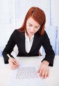 Businesswoman Solving Puzzle — Stock Photo