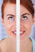 Woman Measuring Height With Measure Tape — Foto de Stock