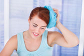 Woman Holding Hot Water Bottle On Head — Stok fotoğraf