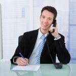 Businessman Using Telephone — Stock Photo #48698015