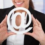 Businesswoman Holding Internet Symbol — Stock Photo #48699271
