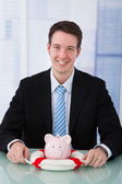 Businessman Protecting Piggybank — Stock Photo