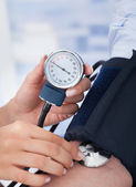Doctor Checking Blood Pressure — Stock Photo
