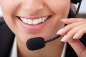 Young Businesswoman Talking On Headset — Stock Photo