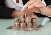 Businesswoman's Hand Stacking Coins — Stock Photo
