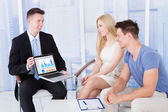 Financial Advisor Showing Graph  To Couple — Stock Photo
