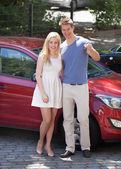 Young Couple Holding Key By New Car — Stock Photo