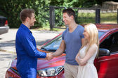 Mechanic Handshaking With Couple By Car — Stock Photo