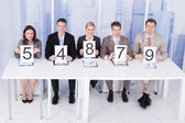 Business People Showing Score Cards — Foto Stock