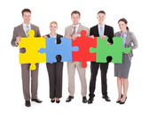 T Business People Holding  Jigsaw Puzzle — Stock Photo