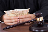 Judge Counting Money At Desk — Stock Photo