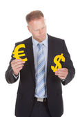 Businessman Choosing Between Euro And Dollar — Stock Photo