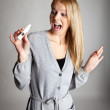 Young woman scared of pregnancy test results — Stock Photo #4906596