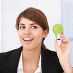 Businesswoman Holding Light Bulb — Stock Photo #49569843