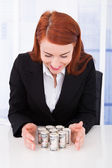 Businesswoman Protecting Rolled Dollar Bills — Stok fotoğraf