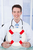 Doctor Holding Lifebuoy — Stock Photo